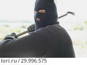 Купить «Burglar with crowbar in his hand», фото № 29996575, снято 29 июня 2012 г. (c) Wavebreak Media / Фотобанк Лори