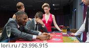 Купить «Women comforting man as other man takes jackpot», фото № 29996915, снято 20 июля 2012 г. (c) Wavebreak Media / Фотобанк Лори