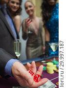 Купить «Man is throwing dice », фото № 29997187, снято 20 июля 2012 г. (c) Wavebreak Media / Фотобанк Лори