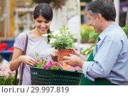 Купить «Woman buying plants», фото № 29997819, снято 24 июля 2012 г. (c) Wavebreak Media / Фотобанк Лори
