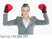 Купить «Businesswoman raising her hands with boxing gloves», фото № 29998767, снято 31 июля 2012 г. (c) Wavebreak Media / Фотобанк Лори