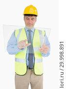 Купить «Man in vest and with helmet holding pane», фото № 29998891, снято 31 июля 2012 г. (c) Wavebreak Media / Фотобанк Лори