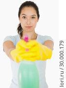 Купить «Brunette woman pointing spray bottle», фото № 30000179, снято 8 августа 2012 г. (c) Wavebreak Media / Фотобанк Лори