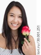 Купить «Smiling woman with rose », фото № 30001251, снято 23 августа 2012 г. (c) Wavebreak Media / Фотобанк Лори