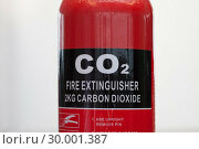 Купить «Carbon dioxide fire extinguisher close up», фото № 30001387, снято 18 марта 2012 г. (c) Wavebreak Media / Фотобанк Лори