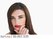 Купить «Woman with red lips holding her chin», фото № 30001535, снято 27 августа 2012 г. (c) Wavebreak Media / Фотобанк Лори