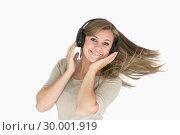 Купить «Woman dancing with headphones», фото № 30001919, снято 3 сентября 2012 г. (c) Wavebreak Media / Фотобанк Лори