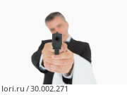 Купить «Waiter holding gun directly ahead», фото № 30002271, снято 13 августа 2012 г. (c) Wavebreak Media / Фотобанк Лори