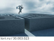 Купить «Businessman leaping above a maze», фото № 30003023, снято 26 июня 2013 г. (c) Wavebreak Media / Фотобанк Лори