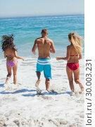 Купить «Friends going bathing in the sea», фото № 30003231, снято 4 апреля 2013 г. (c) Wavebreak Media / Фотобанк Лори