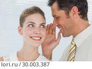 Купить «Employee telling secret to his colleague», фото № 30003387, снято 14 марта 2013 г. (c) Wavebreak Media / Фотобанк Лори