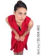 Купить «Pensive mysterious brunette in red dress posing», фото № 30004483, снято 17 апреля 2013 г. (c) Wavebreak Media / Фотобанк Лори
