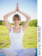 Купить «Happy natural young woman doing yoga», фото № 30004927, снято 26 апреля 2013 г. (c) Wavebreak Media / Фотобанк Лори