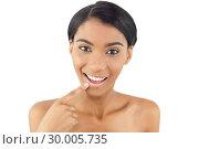 Купить «Smiling woman pointing at her lip», фото № 30005735, снято 23 мая 2013 г. (c) Wavebreak Media / Фотобанк Лори