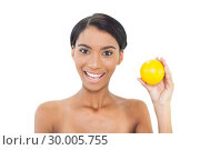 Купить «Smiling attractive model holding orange», фото № 30005755, снято 23 мая 2013 г. (c) Wavebreak Media / Фотобанк Лори