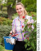 Купить «young woman with long curly hair smells roses flower outdoor», фото № 30006511, снято 18 апреля 2017 г. (c) Яков Филимонов / Фотобанк Лори