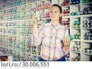Купить «Woman customer holding spray with color paint», фото № 30006551, снято 12 апреля 2017 г. (c) Яков Филимонов / Фотобанк Лори