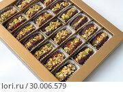 Купить «Dates stuffed with pistachios in a box», фото № 30006579, снято 13 апреля 2018 г. (c) Володина Ольга / Фотобанк Лори
