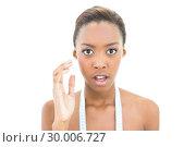 Купить «Surprised natural beauty with measuring tape over the neck», фото № 30006727, снято 7 июня 2013 г. (c) Wavebreak Media / Фотобанк Лори