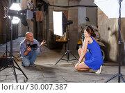 Купить «Photographer taking pictures of brunette woman», фото № 30007387, снято 5 октября 2018 г. (c) Яков Филимонов / Фотобанк Лори