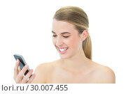 Купить «Happy attractive blonde reading a message on her smartphone», фото № 30007455, снято 12 июня 2013 г. (c) Wavebreak Media / Фотобанк Лори