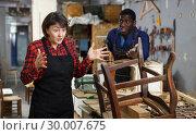 Купить «Portrait of disappointed female artisan», фото № 30007675, снято 2 февраля 2019 г. (c) Яков Филимонов / Фотобанк Лори