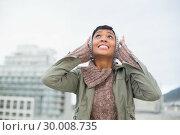 Купить «Troubled young model in winter clothes clogging her ears», фото № 30008735, снято 29 мая 2013 г. (c) Wavebreak Media / Фотобанк Лори