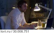 Купить «businessman in headset with laptop at night office», видеоролик № 30008751, снято 11 февраля 2019 г. (c) Syda Productions / Фотобанк Лори