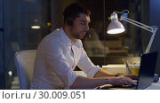 Купить «businessman in headset with laptop at night office», видеоролик № 30009051, снято 11 февраля 2019 г. (c) Syda Productions / Фотобанк Лори