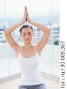 Купить «Relaxed sporty brunette sitting in yoga posture», фото № 30009367, снято 22 мая 2013 г. (c) Wavebreak Media / Фотобанк Лори