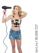 Купить «Concentrated retro blonde model using a hair dryer», фото № 30009727, снято 6 июня 2013 г. (c) Wavebreak Media / Фотобанк Лори