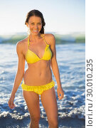 Купить «Cheerful gorgeous woman in yellow bikini bathing in the sea», фото № 30010235, снято 9 мая 2013 г. (c) Wavebreak Media / Фотобанк Лори