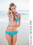 Купить «Sexy blonde in bikini wearing hawaii necklace posing», фото № 30010759, снято 11 июня 2013 г. (c) Wavebreak Media / Фотобанк Лори