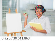 Купить «Funny artistic woman holding scissors and sketchpad», фото № 30011863, снято 28 мая 2013 г. (c) Wavebreak Media / Фотобанк Лори