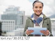 Купить «Close up of smiling woman using tablet», фото № 30012127, снято 16 мая 2013 г. (c) Wavebreak Media / Фотобанк Лори