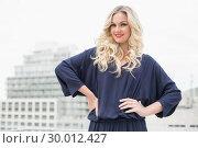 Купить «Smiling gorgeous blonde with red lips posing outdoors», фото № 30012427, снято 15 мая 2013 г. (c) Wavebreak Media / Фотобанк Лори