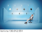 Купить «Businessman on swivel chair looking at holographic cards», фото № 30012551, снято 19 августа 2013 г. (c) Wavebreak Media / Фотобанк Лори