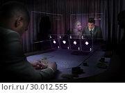Купить «People gambling on table in purple light with holographic card display», фото № 30012555, снято 19 августа 2013 г. (c) Wavebreak Media / Фотобанк Лори