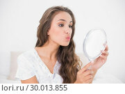 Купить «Attractive brunette posing in front of mirror», фото № 30013855, снято 19 июня 2013 г. (c) Wavebreak Media / Фотобанк Лори