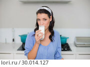 Купить «Content gorgeous model drinking milk», фото № 30014127, снято 20 июня 2013 г. (c) Wavebreak Media / Фотобанк Лори