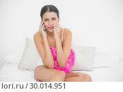 Купить «Devastated young brown haired model in white pajamas being dumped by phone», фото № 30014951, снято 25 июня 2013 г. (c) Wavebreak Media / Фотобанк Лори