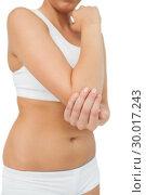 Suffering woman touching her sore elbow. Стоковое фото, агентство Wavebreak Media / Фотобанк Лори
