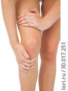 Купить «Close up of slim woman touching her injured knee», фото № 30017251, снято 31 июля 2013 г. (c) Wavebreak Media / Фотобанк Лори