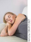 Купить «Casual attractive blonde lying on couch sleeping», фото № 30017927, снято 28 июня 2013 г. (c) Wavebreak Media / Фотобанк Лори