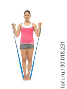 Купить «Stern sporty brunette exercising with resistance band», фото № 30018231, снято 26 июля 2013 г. (c) Wavebreak Media / Фотобанк Лори