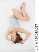 Купить «Pretty slender woman lying on the cover of her bed while sleeping», фото № 30019027, снято 9 июля 2013 г. (c) Wavebreak Media / Фотобанк Лори