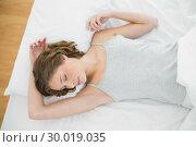 Купить «Calm woman sleeping lying under the cover on her bed», фото № 30019035, снято 9 июля 2013 г. (c) Wavebreak Media / Фотобанк Лори