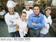 Купить «Handsome manager posing with some chefs and waitress», фото № 30020995, снято 14 августа 2013 г. (c) Wavebreak Media / Фотобанк Лори
