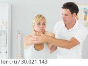 Купить «Handsome physiotherapist examining patients back», фото № 30021143, снято 26 июля 2013 г. (c) Wavebreak Media / Фотобанк Лори