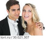 Smiling handsome bridegroom posing with his wife . Стоковое фото, агентство Wavebreak Media / Фотобанк Лори